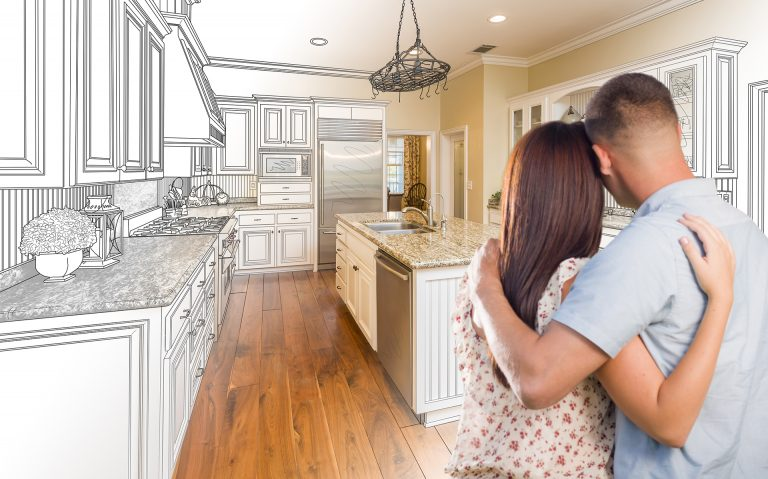 couple looking at new kitchen while hugging